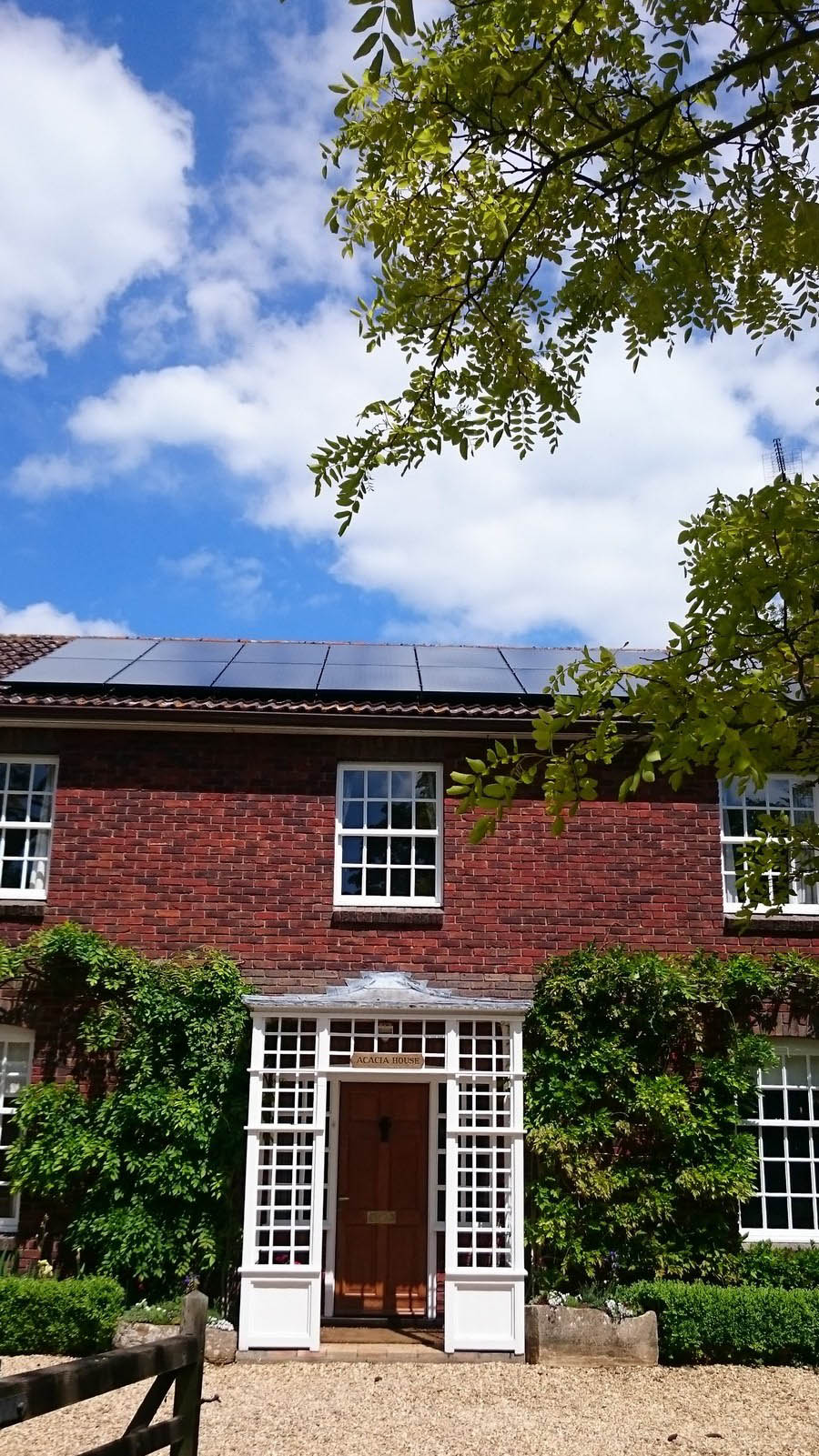 Solar panels on the roof of a large house near Cambridge
