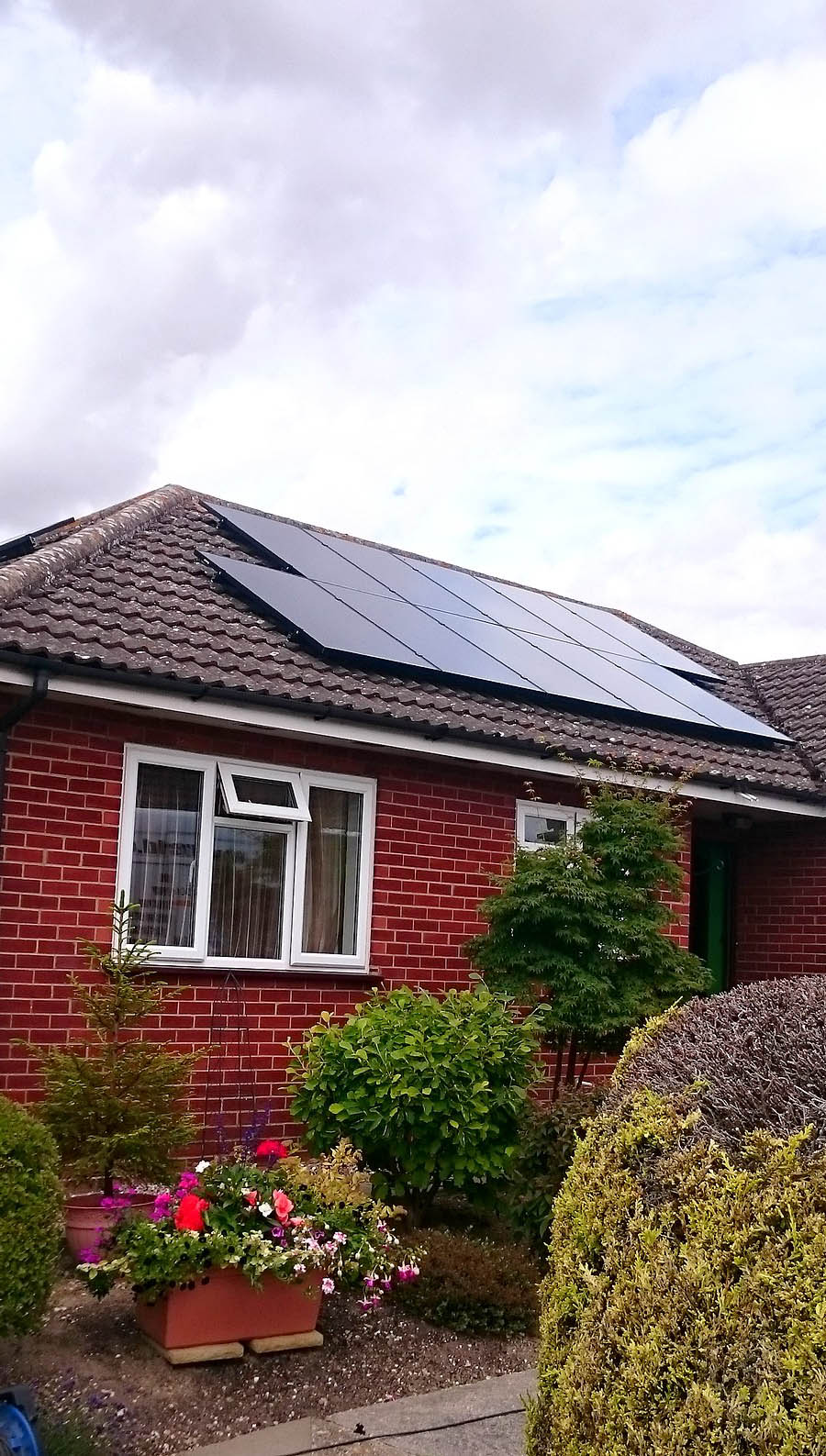 Solar panels on the roof of a large bungalow near Cambridge