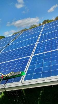 Solar panels near Cambridge cleaning in progress