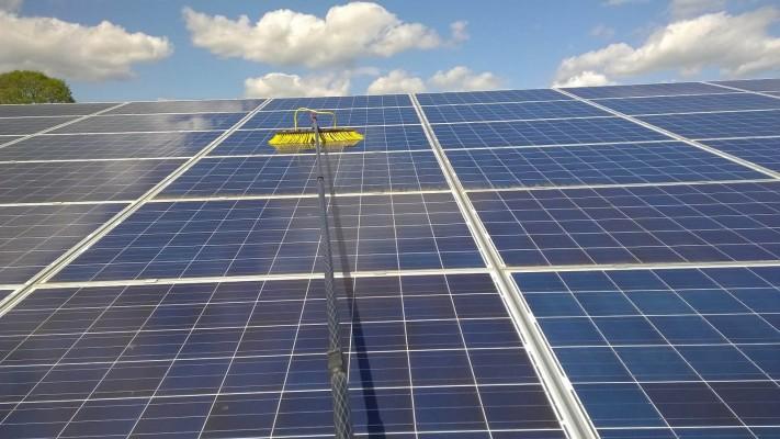 Solar panel farm near Cambridge cleaning in progress