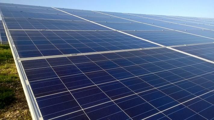 Shining solar panels near Cambridge working hard at full capacity