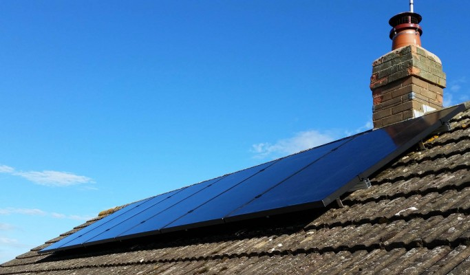 Six solar panels installed on a open gable type roof in Cambridge