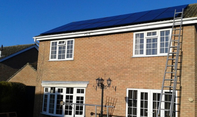 Large numbers of solar panels installed on a house in Cambridge