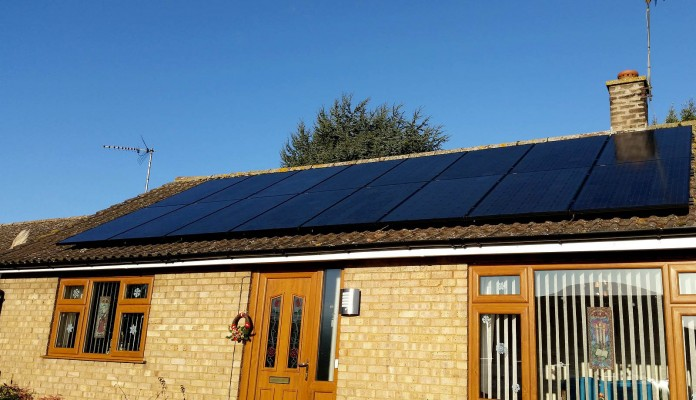Large number of solar panels on a bungalow type house near Cambridge