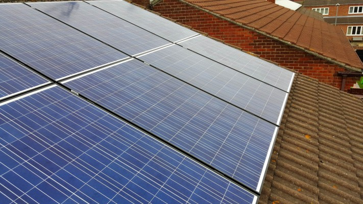 Brand new solar panels installed on an open gable roof in Cambridge
