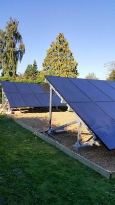 Solar farm with multiple rows of solar panels near Cambridge