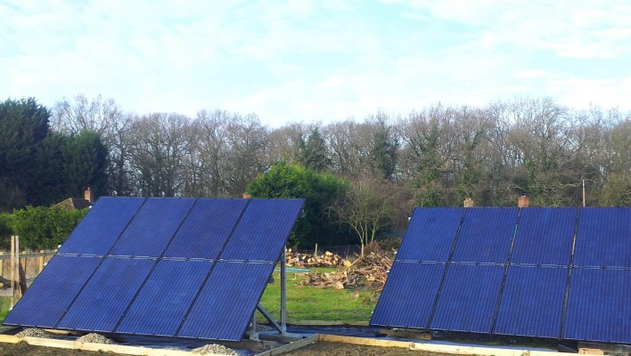 Solar farm near Cambridge producing good amount of electricity on a cloudy spring day