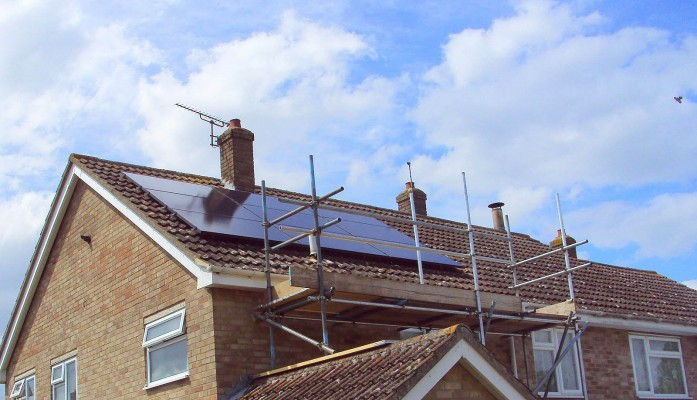 Nine large solar panels producing free electricity for a family from Cambridge