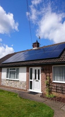 Two rows of solar panels provide good amount of electricity for a family living in a bungalow near Cambridge