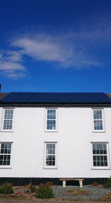 Large renovated house with sixteen solar panels producing free electricity for a family living near Cambridge