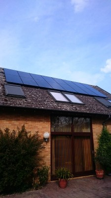 Box gable roof with two rows of solar panels near Cambridge