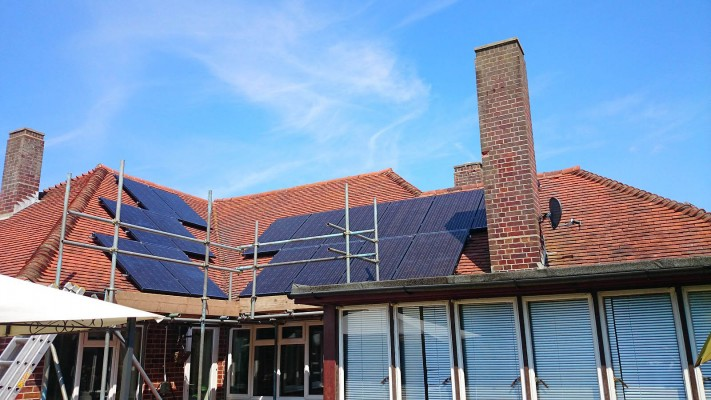 Work in progress solar panels installation over a very large house near Cambridge