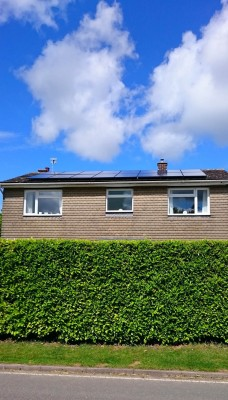 Beautiful summer day and solar panels generating free electricity for a family living in a detached house in Cambridgeshire