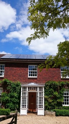 Large detached house in Cambridge outskirts with massive solar panels producing free electricity