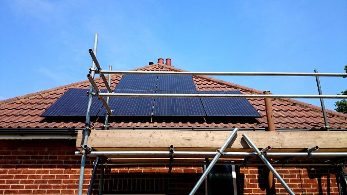Work in progress solar panels installation on a pyramid style roof near Cambridge