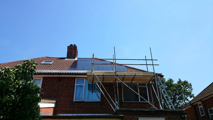 Work in progress tidy installation of solar panels over a semi-detached house near Cambridge