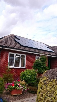 Bungalow house near Cambridge with a set of ten solar panels generating free electricity