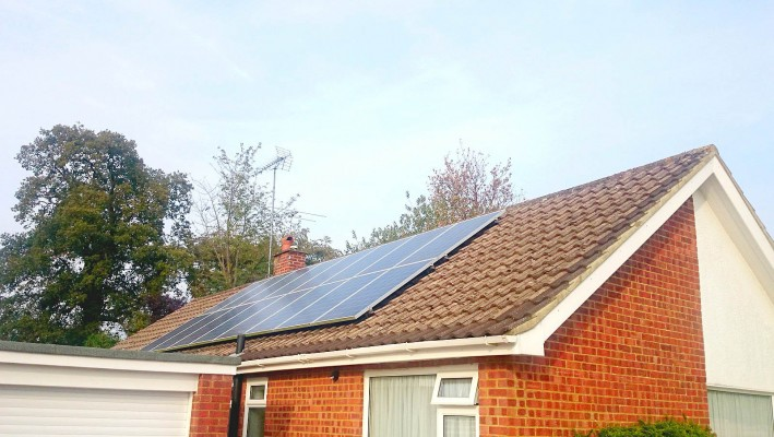 Two rows of solar panels installed on a sunny summer day on a detached house near Cambridge