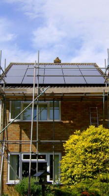 Work in progress solar panels installation over a house near Cambridge