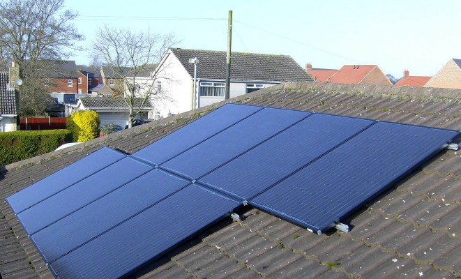 Cambridge neighbourhood and eight solar panels producing free electricity