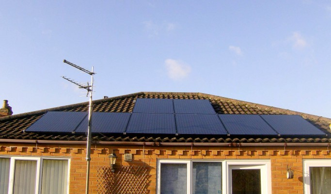 Eight solar panels over a bungalow house near Cambridge producing free energy