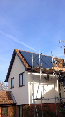Solar panels being installed on a large family house near Cambridge