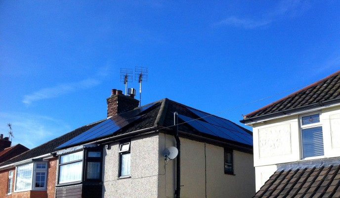 Cambridge village house with two sets of solar panels producing free green energy