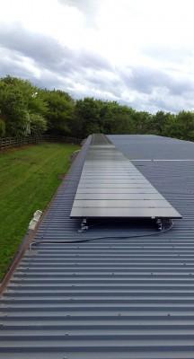 Solar panels producing electricity for a farm near Cambridge