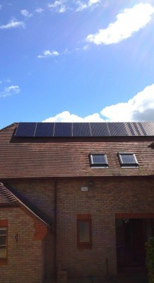 Large house with solar panels generating electricity for a Cambridge-based family