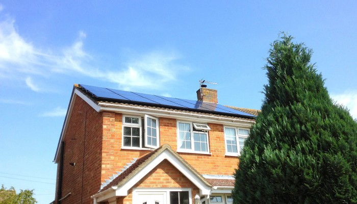 Beautiful detached house with solar panels generating electricity for a Cambridge-based family